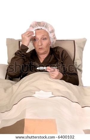 Middle aged woman with cold, sick in bed,  Curlers and net in hair.