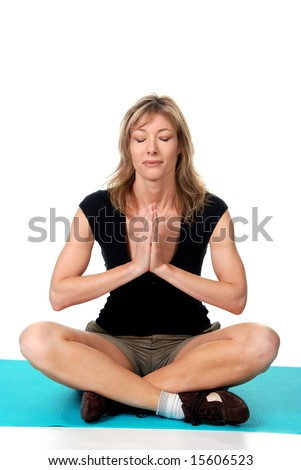 middle aged women doing yoga on a mat