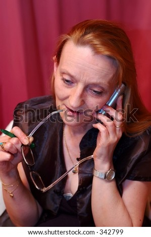 Middle aged women with cellular phone.