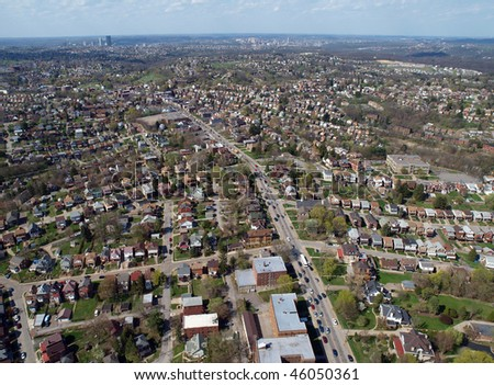 Middle America aerial, high over Pittsburgh Pennsylvania neighborhoods.