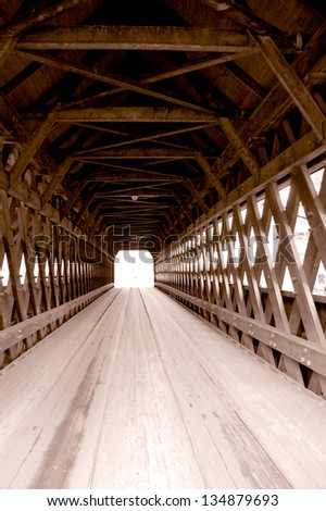 Middle Covered Bridge in Woodstock, Vermont spans the Ottauquechee River. The town lattice bridge, built in 1969, is 139 feet long and carries vehicular as well as pedestrian traffic.