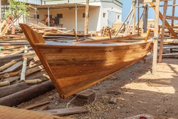 Middle East, Arabian Peninsula, Oman, Al Batinah South, Sur. A wooden rowboat in a boatyard at Sur, Oman.