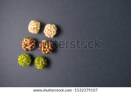 Middle east pistachio, peanut, peach and apricot confectionery snack. Healthy no sugar food. Copy space on the right side. Light on the objects.