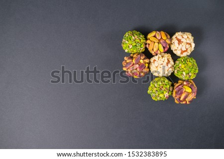 Middle east pistachio, peanut, peach and apricot confectionery snack. Healthy no sugar food. Copy space on the left.