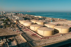 Middle East water and gas containers along the coastline for gas, water and oil concepts. Industrial zone.