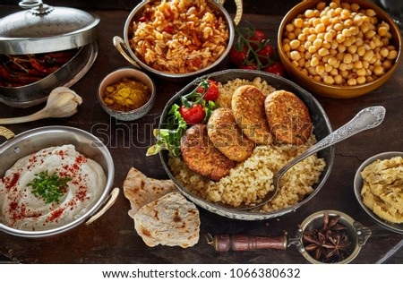 Middle Eastern cuisine food served in metal pans and dishes viewed from high angle in close-up full frame studio shot