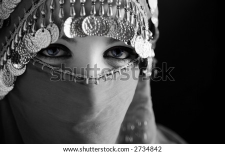 middle eastern culture: belly dancer with traditional veil