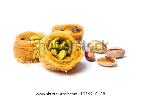 Middle Eastern dessert with pistachio called mabroume or burma isolated #1076910188
