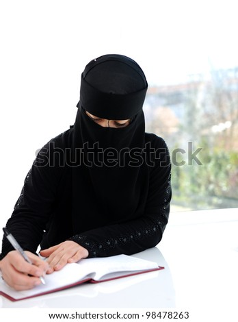 Middle eastern girl writing
