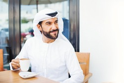 Middle eastern man enjoying coffee in a cafe