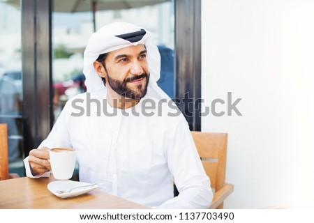 Middle eastern man enjoying coffee in a cafe
