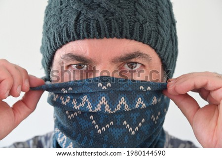 Middle Eastern Militant Man disguising his identity by wearing a beanie and balaclava face cover. Photo stock ©