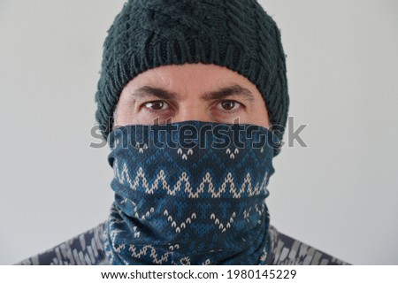 Middle Eastern Militant Man disguising his identity by wearing a beanie and balaclava face cover looking at camera. Photo stock ©