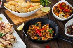 Middle eastern or arabic dishes and assorted meze, concrete rustic background. Meat kebab, falafel, baba ghanoush, muhammara, hummus, sambusak, rice, tahini, kibbeh, pita. Halal food. Lebanese cuisine