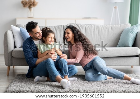 Middle Eastern Parents Having Fun With Their Little Daughter At Home