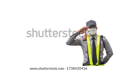 Middle old of Asian security guard with mask make saluting, isolated on white background. Male security guard. Security Guard Talking a portable wireless transceiver guard entrance. For web design.