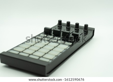 midi controller for disc jockey,sound producer & composer.Create electronic musical tracks with modern digital beat machine with knobs and pads isolated on white background, music concept