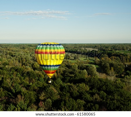MIDLAND, MICHIGAN-SEPTEMBER 17:  Hot air balloon participates in the 20th annual Balloon Festival fly on September 17, 2010 over Midland, MI countryside. This year 65 balloons participated.