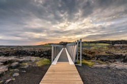 Midlina Bridge bridges the gap between the continental drift of Europe and North America, Sandvic, Reykjanes Peninsula, Iceland