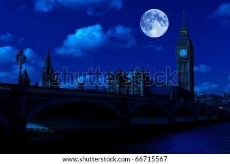 Midnight picture of the Big Ben and Westminster Bridge in London with a full moon
