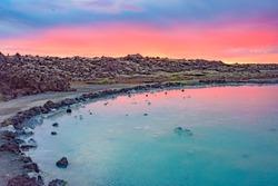 Midnight sun over the Blue Lagoon geothermal spa, near Grindavik, Reykjanes peninsula, Iceland