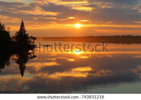 midnight sun with water reflection at lake inari in finland, scandinavia, europe #743831218