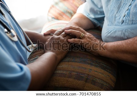 Shutterstock Midsection of nurse and patient relaxing at sofa in nursing home
