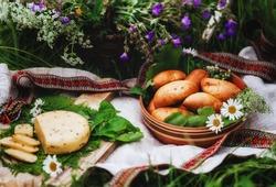 Midsummer in Latvia. Latvia summer. Traditional Latvian midsummer food. Celebration of Ligo in june decorating home with field flower bouquet. Symbolism of Latvia for Ligo holiday.