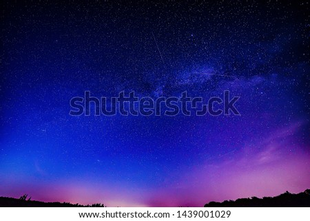 Midsummer Milky Way and satellite light in the night sky.