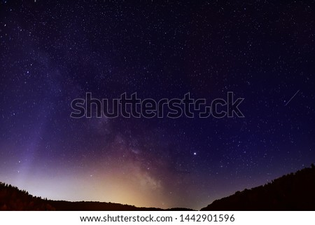 Midsummer Milky Way, Jupiter and Saturn Planets and satellite traces in the night sky.