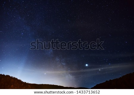 Midsummer Milky Way, Jupiter, Saturn and satellite light in the night sky.