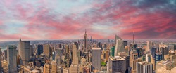 Midtown Manhattan at sunset, New York City. Panoramic aerial view of city skyscrapers at dusk.