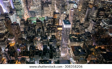 Midtown Manhattan (New York) lit up from above.