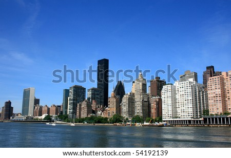 Midtown Manhattan skyline along the East River as seen from Roosevelt Island. - stock photo
