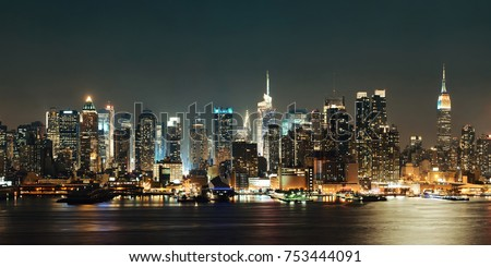 Midtown Manhattan skyline at dusk panorama over Hudson River #753444091