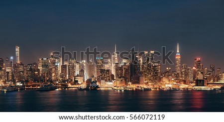 Midtown skyline over Hudson River panorama in New York City with skyscrapers at night #566072119