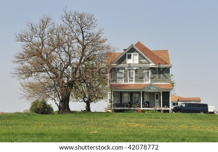 Midwest Farmhouse and Bare Tree