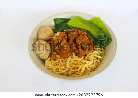 mie ayam or noodles chicken is traditional  food from indonesia, asia made from  noodle, chicken, chicken broth, spinach, sometimes with meatball, isolate on white background  Zdjęcia stock ©