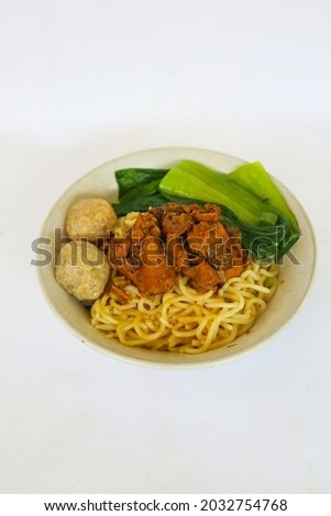 mie ayam or noodles chicken is traditional  food from indonesia, asia made from  noodle, chicken, chicken broth, spinach, sometimes with meatball. isolated on white background Zdjęcia stock ©