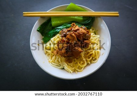 mie ayam or noodles chicken is traditional  food from indonesia, asia made from  noodle, chicken, chicken broth, spinach, sometimes with meatball.  Zdjęcia stock ©