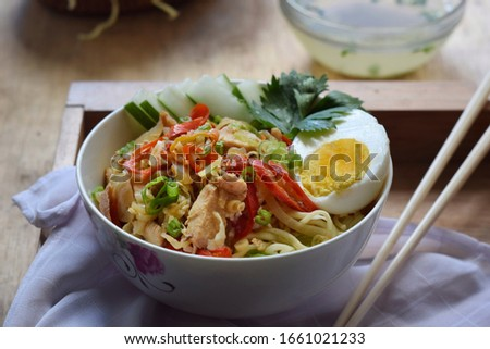 mie ayam rica-rica is noodles with rica-rica chicken topping, which is coarse chopped chicken with spicy seasoning