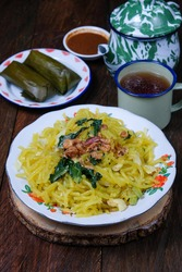 Mie Glosor or Glossy noodles, Indonesian food made from noodles derived from sago flour (aci) mixed with turmeric, popular takjil for breakfasting in Ramadhan.