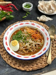 Mie lendir khas tanjung pinang is one of the typical foods from Tanjungpinang, Indonesia. has a thick brown broth, made from beans and yams. served with boiled eggs, celery, cucumbers and bean sprouts