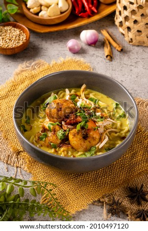 Mie Soto Ayam or Soto Medan with prawn is Traditional chicken soup with Noodle from North Sumatra.   Soto is a traditional Indonesian soup mainly composed of broth, meat, fried patties and vegetables Zdjęcia stock ©