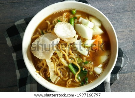 Mie tek-tek or mie dok-dok or boiled noodle soup with spices, thick and tasty gravy. Stok fotoğraf ©
