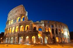 Mighty Coliseum (AD 80), illuminated at night, Rome, Italy.