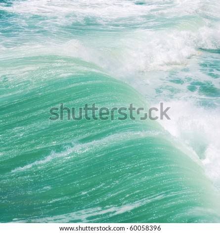 Mighty turquoise sea waves create a beautiful abstarct background