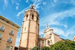 Miguelete tower and Cathedral in Valencia, Spain during the sunny day, cloudy sky