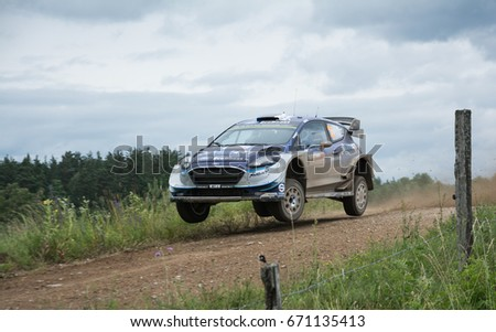 MIKOLAJKI, POLAND - JUL 1: Ott Tanak and his codriverMartin Jarveoja  in aFord Fiesta WRC race in the 74nd Rally Poland, on July 2, 2017 in Mikolajki, Poland. #671135413