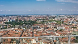 Milan aerial view of residential buildings and the Garibaldi railway station in the business district timelapse fiew from rooftop. Houses with red roofs. Blue cloudy sky at summer day